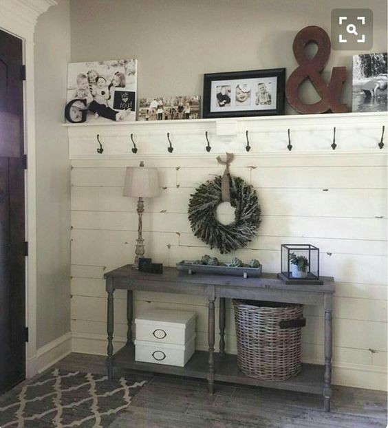 I am in LOVE with this mudroom idea!  I need some more baskets to really organize and keep all the STUFF in our foyer organized but this is such a pretty DIY mud room idea!