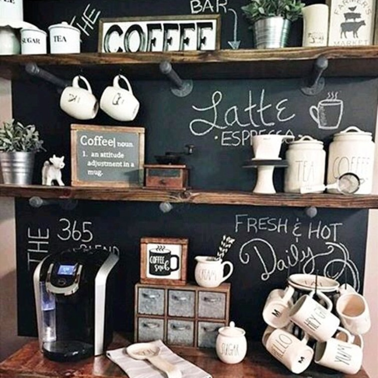 Creative DIY coffee bar idea!  Love the chalkboard wall behind this small kitchen coffee station - the industrial pipe shelving is gorgeous too