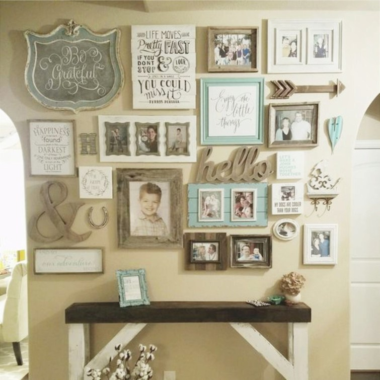 Love this shabby chic gallery wall in this farmhouse style home!