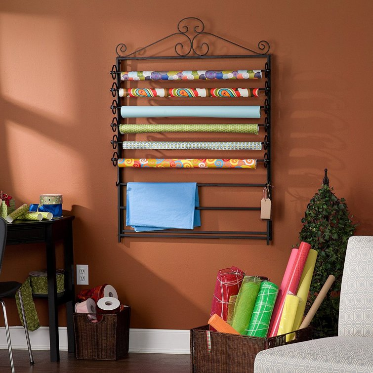 Wrapping paper organizer that hangs on the wall.  Smart idea