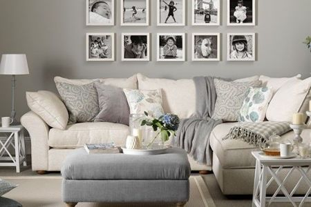 10 Ways To Add Character To Your Living Room   Decoholic gray and white living room with family photo frames on the wall