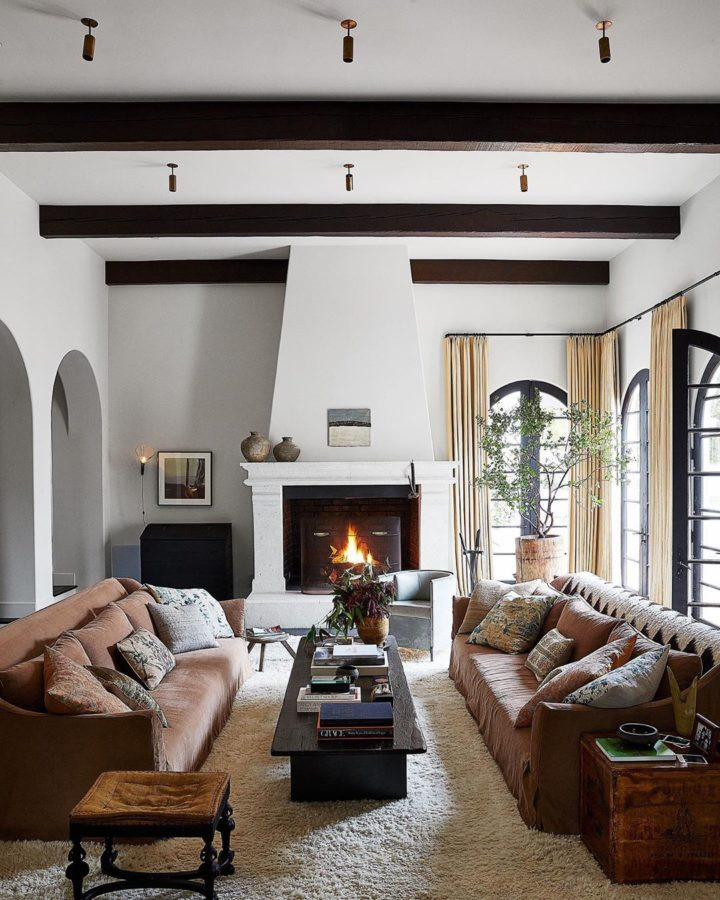 small living room with 2 sofas and fireplace