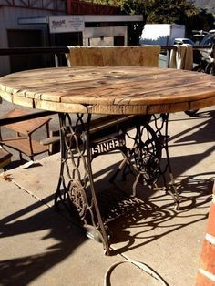 2. Table made with an old sewing machine base and a cable spool