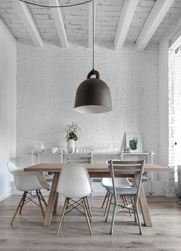 Mix of chairs around a Scandinavian table design. Stick system library behind by Jan&Henry
