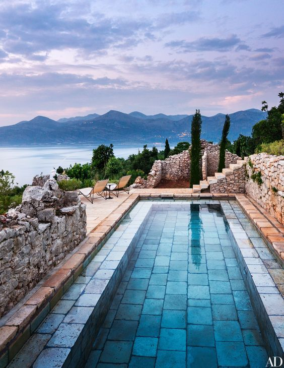 decoralinks | a stone-paved pool by Rees Roberts + Partners