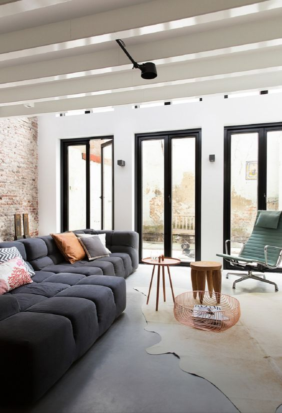 decoralinks | Living room with a blue sofa from BBItalia and an Eames style armchair