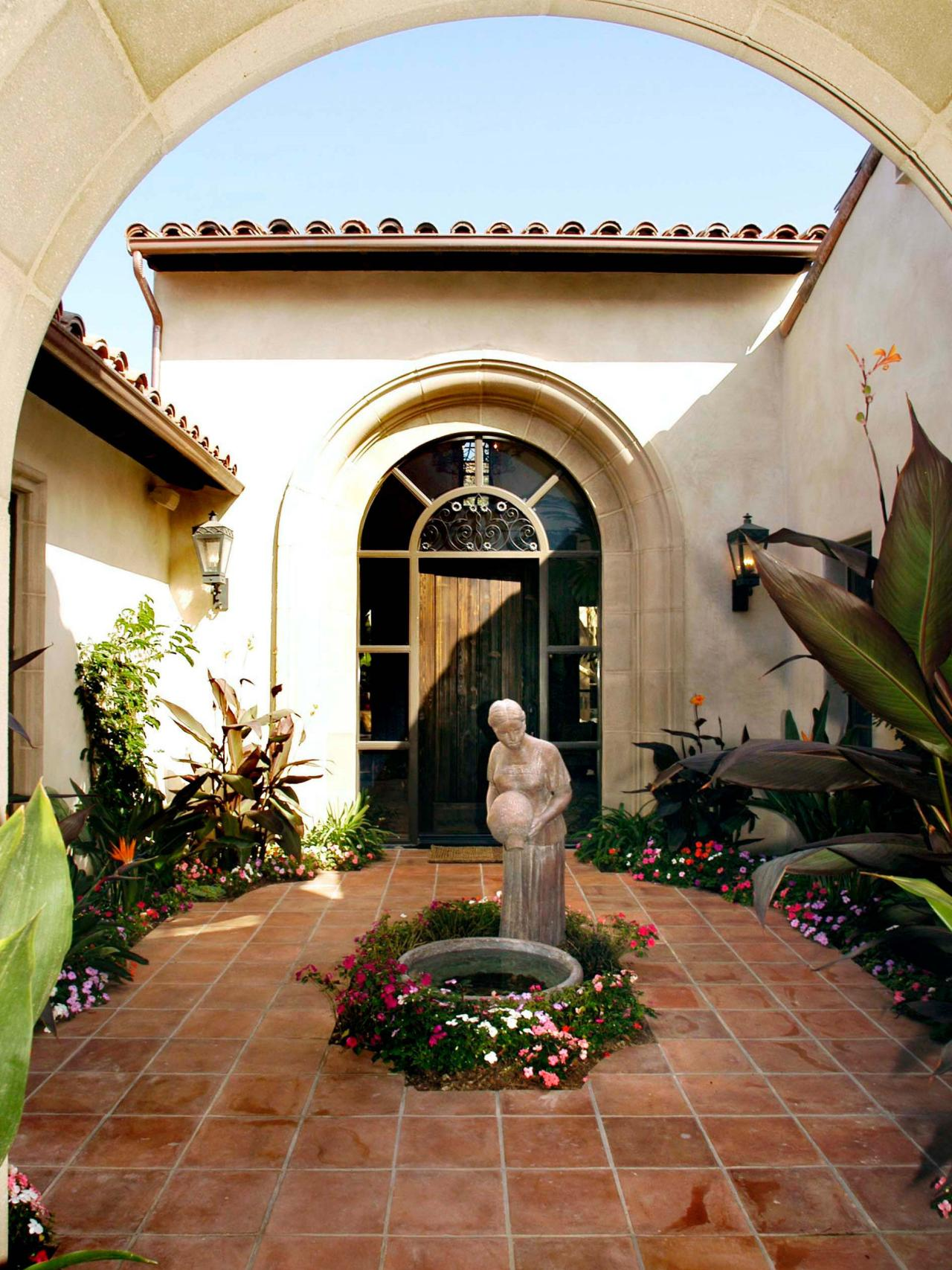 Mediterranean Outdoor Foyer With Statue Fountain