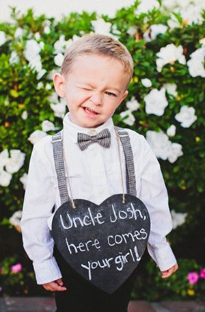 cute-ring-bearer-with-chalkboard-wedding-signs