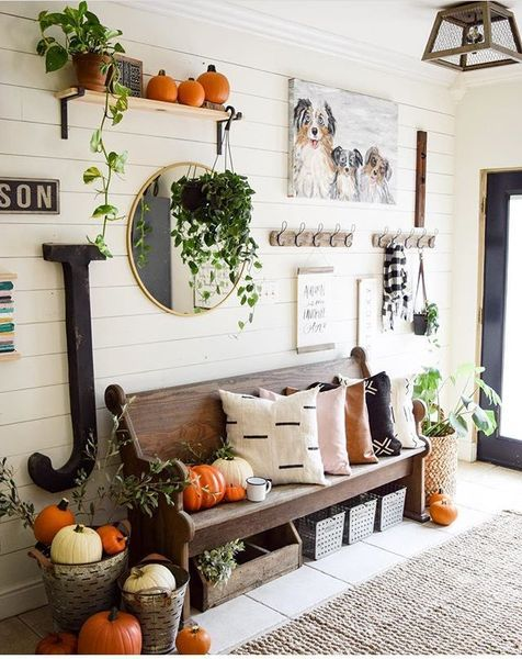 Cozy And Fresh Entry Way With Greenery And Plenty Of Pumpkins