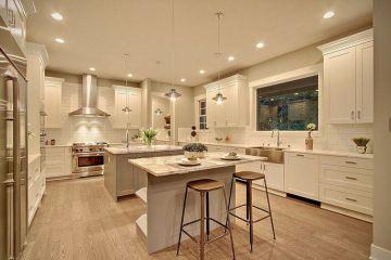 White Kitchen with Island Green