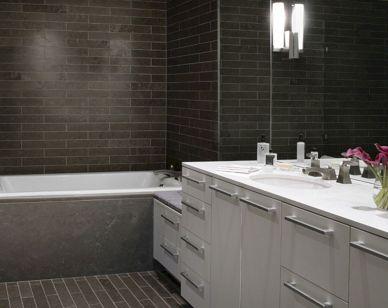 Brown Subway Tile Bathroom with Shower Vanity