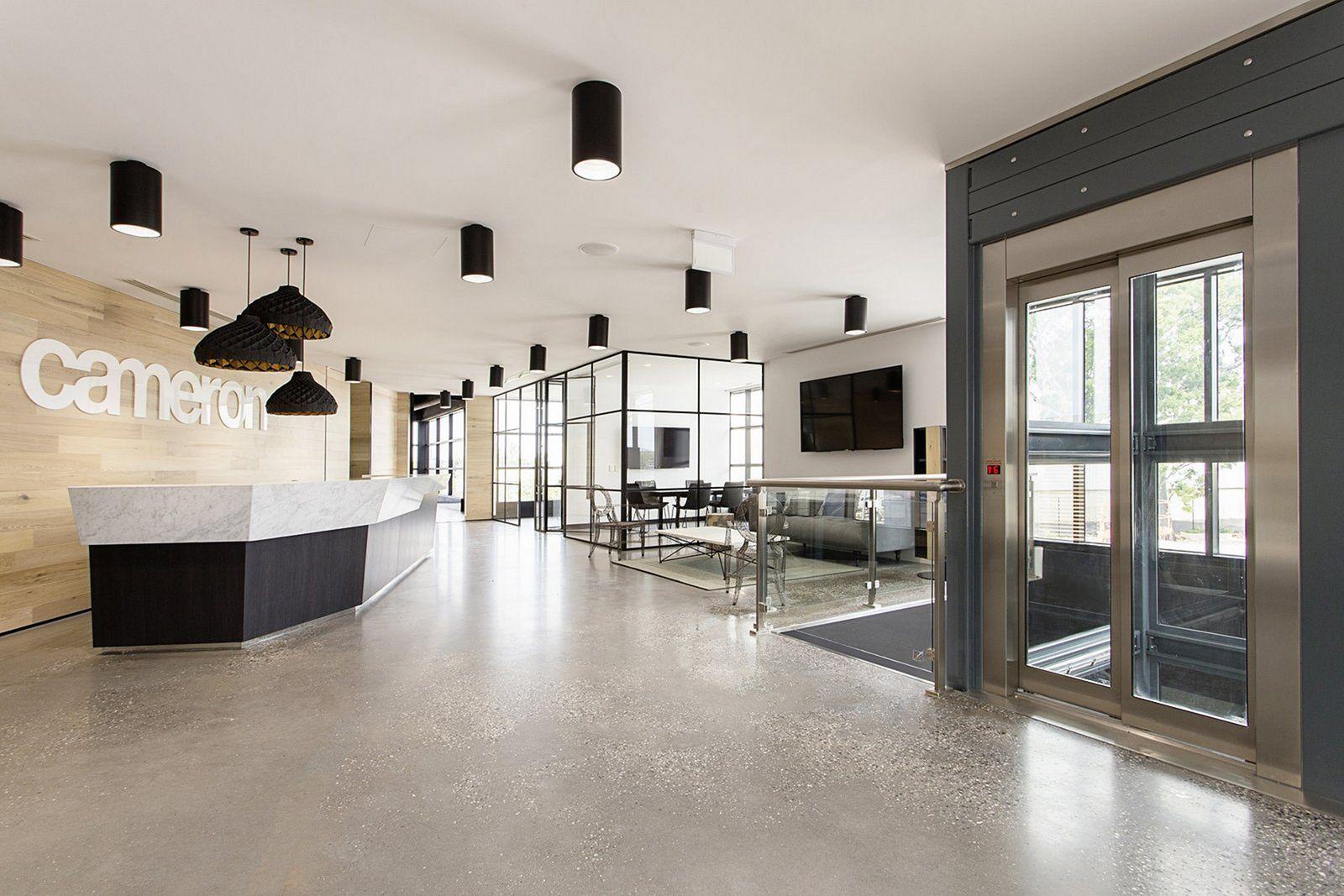 Industrial office lobby design decoredo for Industrial office design