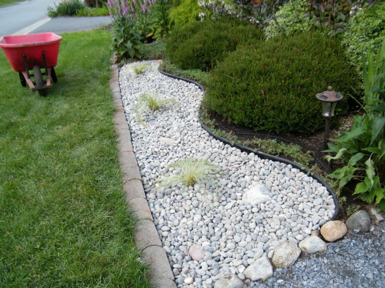 Front Yard Landscaping Ideas with White Rocks 5