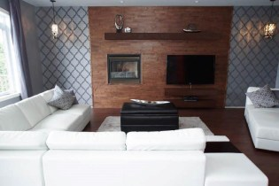 Conception d'un manteau de foyer avec système audio intégré, afin de centraliser l'espace salon