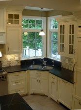 Cream Kitchen Cabinets With Black Countertops