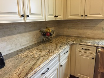Cream Kitchen Cabinets With Grey Granite Countertops