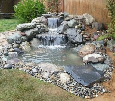 Creative Backyard Ponds Ideas With Waterfalls To Try 10