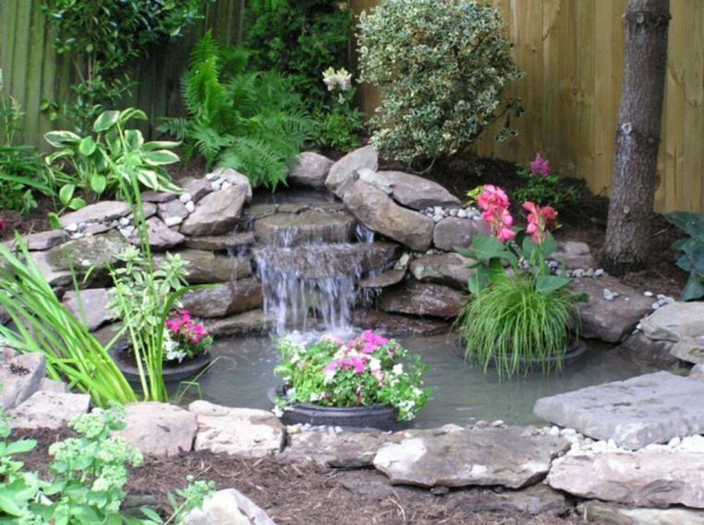 Creative Backyard Ponds Ideas With Waterfalls To Try 25