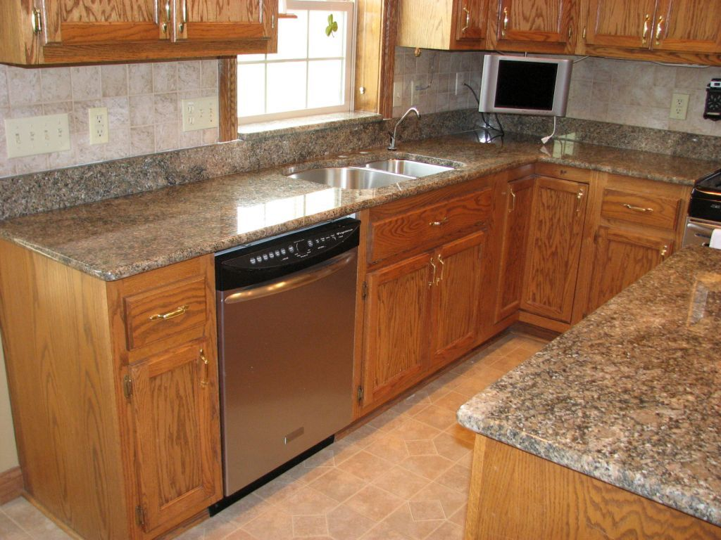 Golden Oak Cabinets With Quartz Countertops