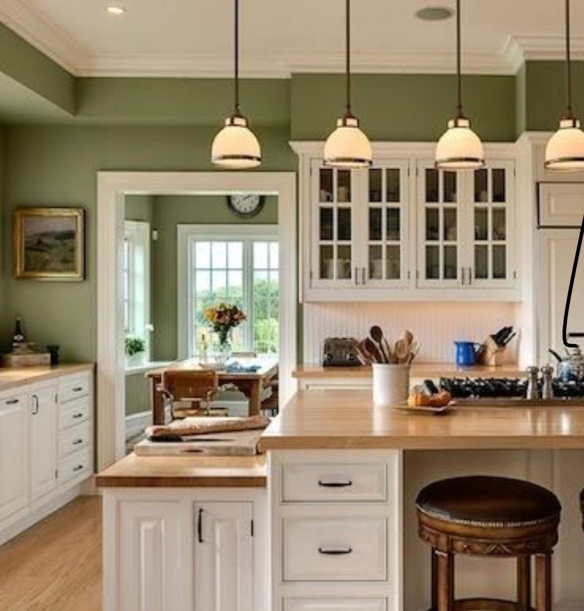 Green Kitchen With White Cabinetry
