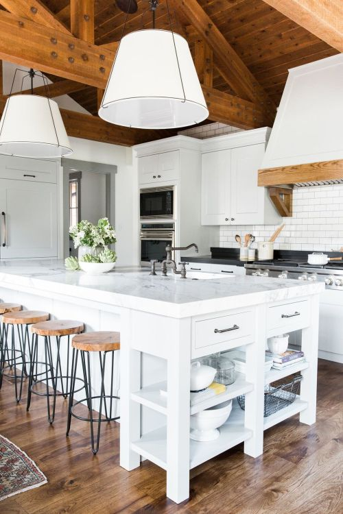 Modern farmhouse kitchen with exposed beams and a wood ceiling