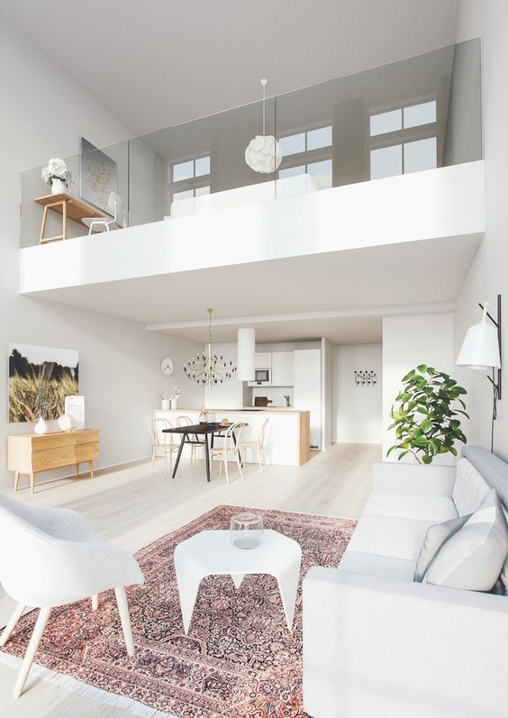 White, crisp, Persian rug, mezzanine, vide, glass partition, white chairs: