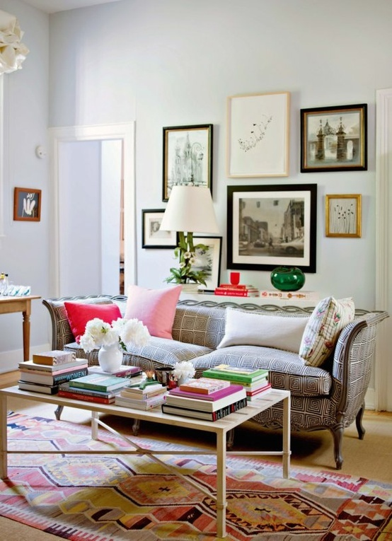 Dozens of photo frames, cushions and coffee table books - the necessity to every lounge room.