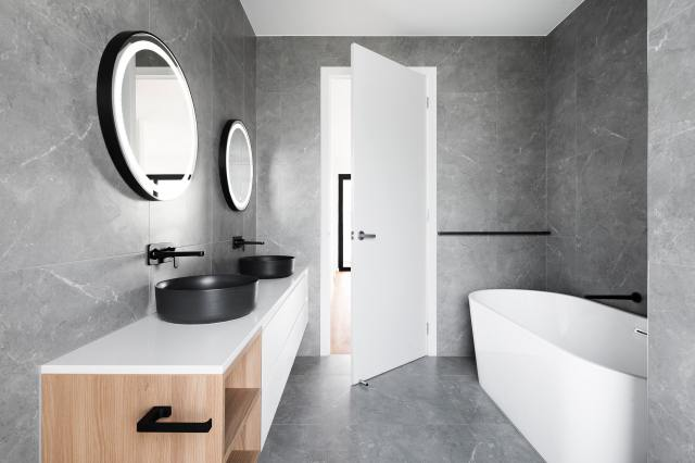 Bathroom with tub and mirrors