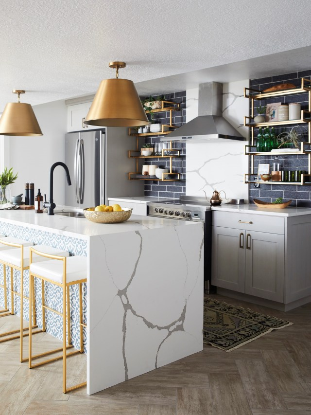 Kitchen with bar table with tiles, kitchen elements and bar chairs
