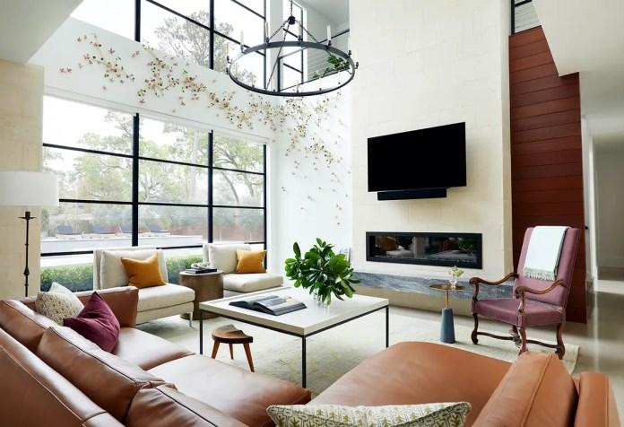 Living room with big windows, sofa, coffee table and TV