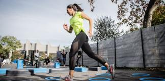Woman running at outdoor gym