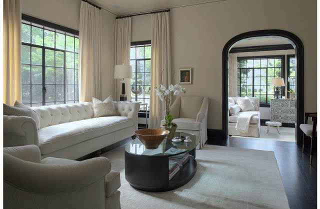 Bright designed living room with sofa, armchair and coffee table