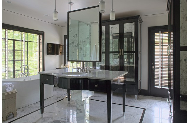 Bathroom with sink and mirror