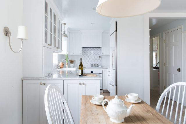 White-designed kitchen and dining room