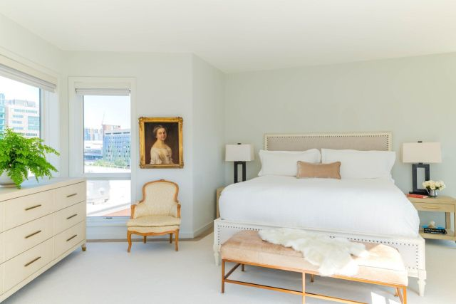 White designed bedroom with double bed
