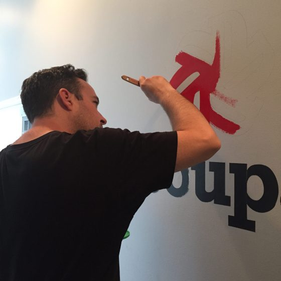 Painting a new sign in the NY office!