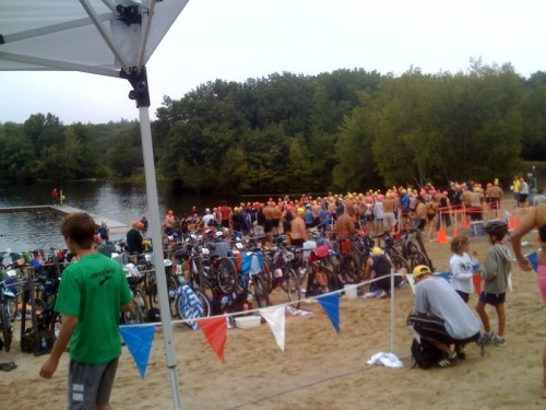 Pic of the beach staging area at the Hale Reservation Triathalon .