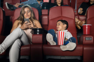 mother and son at movies