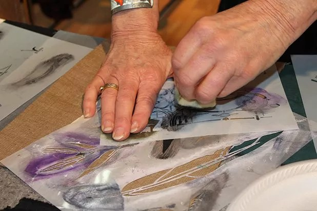 Diane demonstrating painting with a stencil