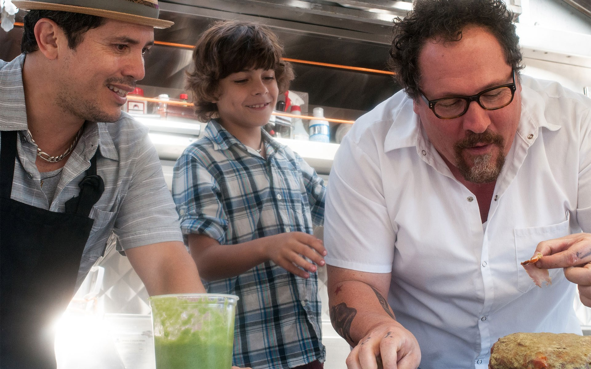 John Leguizamo, Emhay Anthony, and Jon Favreau in Chef