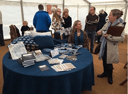 The author in the book-signing tent at the IOWLF
