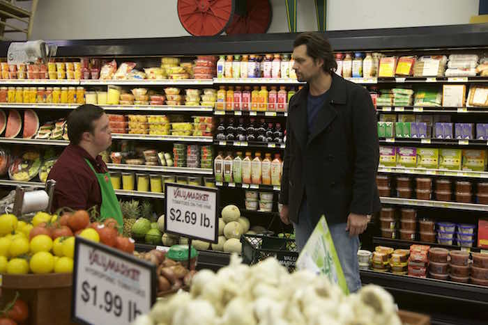 """Kristoffer Polaha (""""Calvin"""") meets David DeSanctis (""""Produce"""") in a scene from Roadside Attractions' """"Where Hope Grows."""" Photo credit: Tom LeGoff"""
