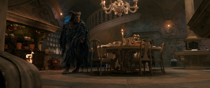 The Beast (Dan Stevens) with Lumiere the candelabra and Cogsworth the mantel clock in the castle kitchen in Disney's BEAUTY AND THE BEAST, a live-action adaptation of the studio's animated classic which is a celebration of one of the most beloved stories ever told.