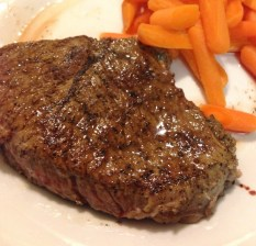 Medium rare steak with carrots