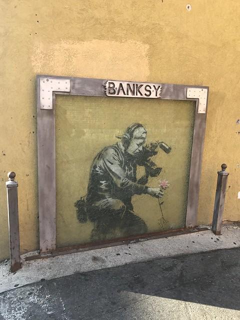 Banksy Camera Man and Flower, Park City UT