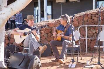 John pat peace place two men playing guitar