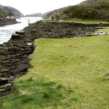The shallow constriction known as the Rapids at Lough Hyne is no more than 5m deep at high tide with current speeds reaching 3 m/s. This lead to considerable erosion and damage to the Famine Wall as can be seen in this photograph taken by Dr. Rob McAllen of