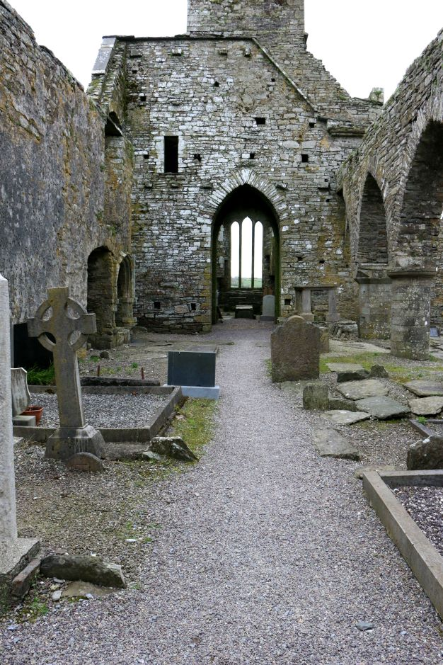View of the interior of the Nave at Timoleague Friary with a view of the crossing tower and choir window to the east. The east choir is a triple lancet window similar to that found in the south transept.