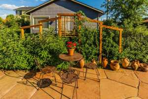Locally harvested flagstone patio with privacy screen.