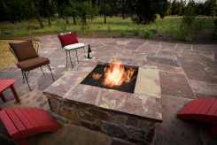 Firepit encompassed by a locally harvested chocolate flagstone patio